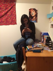 my wonderful roommate Sohini, sitting on her desk after rearranging our triple to reflect that only two of us were now living there.